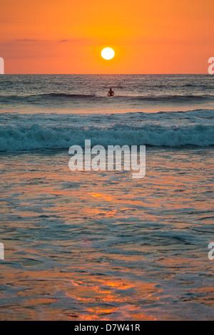 Sunset at Playa Guiones surfing beach, Nosara, Nicoya Peninsula, Guanacaste Province coast, Costa Rica - Stock Photo