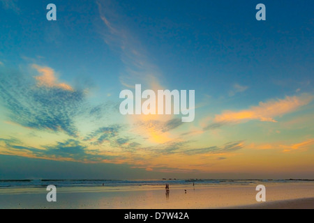 Pacific sunset at popular Playa Guiones surf beach, Nosara, Nicoya Peninsula, Guanacaste Province, Costa Rica - Stock Photo