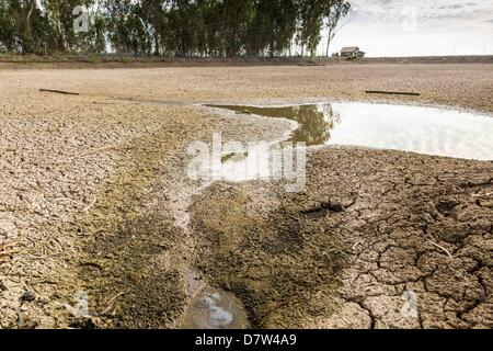 Bangtathen, Saphun Buri, Thailand. May 14, 2013. An empty shrimp pond on a shrimp farm in Saphunburi province of - Stock Photo