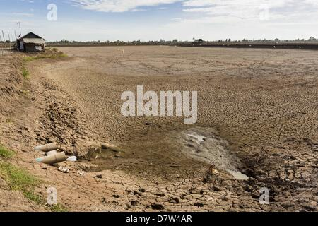 Bangtathen, Saphun Buri, Thailand. May 14, 2013. An empty shrimp pond on a shrimp farm in Saphunburi province of - Stock Photo