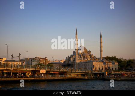 The new mosque (Yeni Cami) and Galata Bridge, Istanbul, Turkey - Stock Photo
