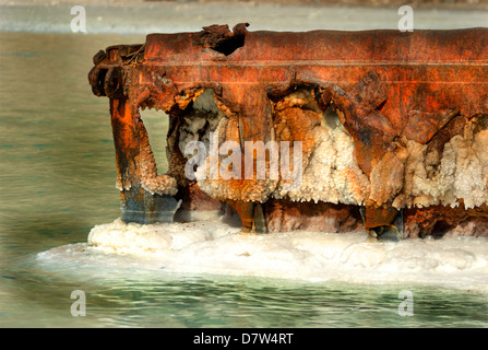 Israel, Dead Sea, salt crystalization on a metal pier caused by water evaporation