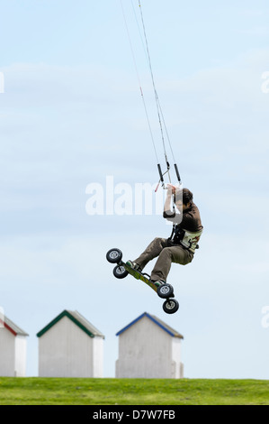 A land boarder performs tricks and jumps at Goring Gap, Worthing. Features Slight Blur due to speed of action - Stock Photo