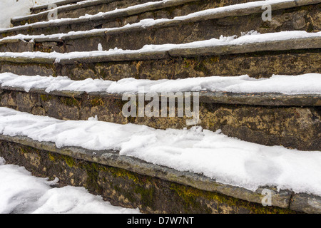 Snow covered steps on Mt Floyen Bergen Norway - Stock Photo