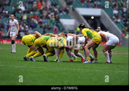The Australia and England women's Sevens teams about to lock into a scrum during the Women's Invitational International - Stock Photo