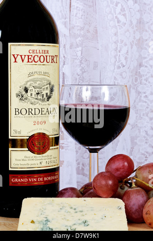 Bleu d'Auvergne cheese, red wine and red grapes. - Stock Photo
