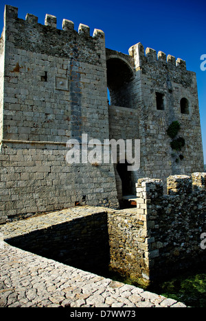 Entrance to Methoni Castle from the sea, clear blue sky in background at sunny summer day. - Stock Photo