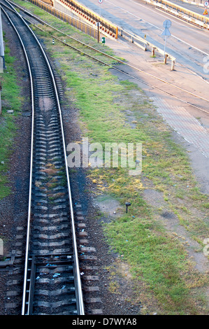 Railway tracks stretching into the distance. - Stock Photo