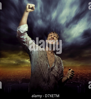 Dirty guy in natural triumph pose - Stock Photo