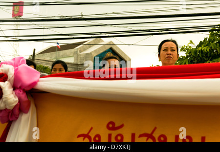PHUKET, THAILAND -OCTOBER 1 2011: Spectators  watch a street procession during the annual Phuket Vegetarian Festival. - Stock Photo