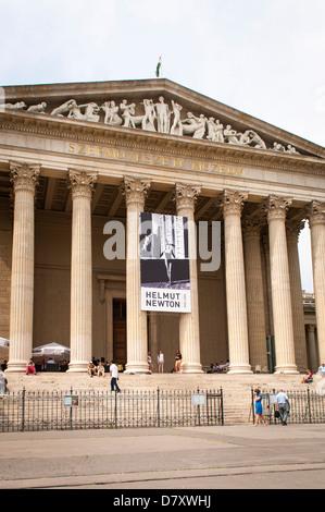 Budapest Hungary Varoliget District Hero's Milennium Square portico Museum of Fine Arts banner Helmut Newton exhibition - Stock Photo