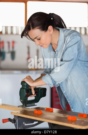 Woman working in workshop - Stock Photo
