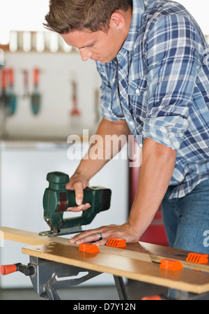 Man working in workshop - Stock Photo