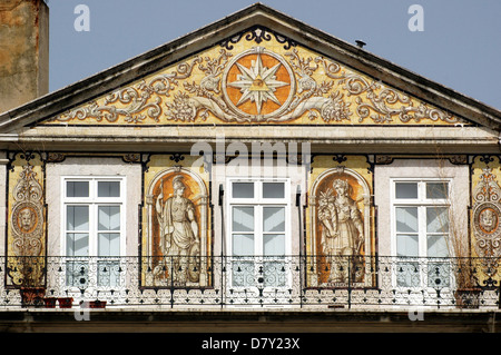 Facade of Casa do Ferreira das Tabuletas house which dates to 1864 decorated with azulejos hand-painted tiles depicting - Stock Photo