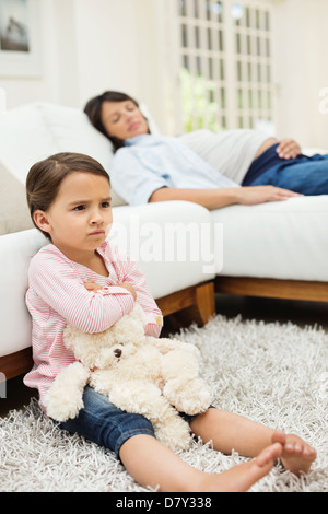Angry girl watching television with mother - Stock Photo