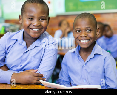 Students smiling in class - Stock Photo