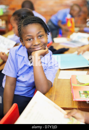 Student smiling in class - Stock Photo