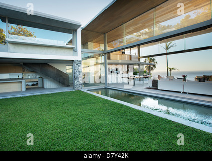 Swimming pool and patio of modern house - Stock Photo