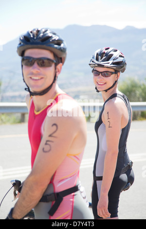 Cyclists smiling before race - Stock Photo