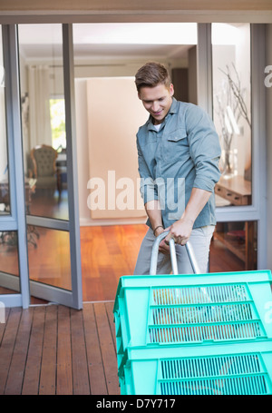 Man making deliveries on front porch - Stock Photo