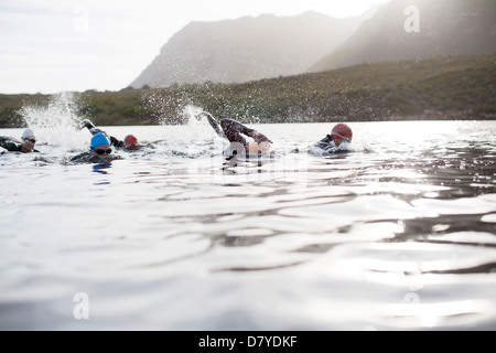 Triathletes swimming - Stock Photo
