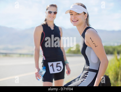 Runners smiling together outdoors - Stock Photo