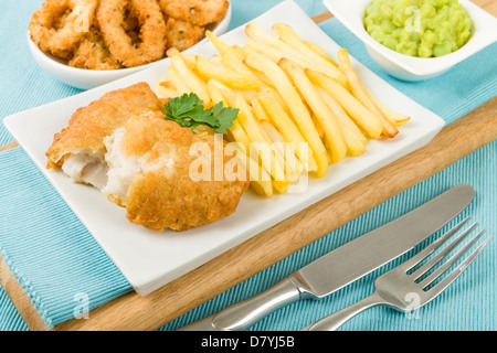 Fish & Chips - Battered cod fillet, chips and mushy peas. - Stock Photo