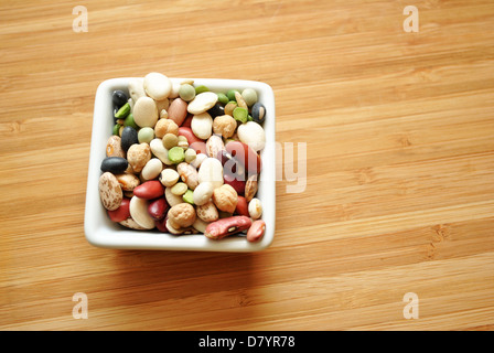Different Dried Beans in a White Square Bowl - Stock Photo