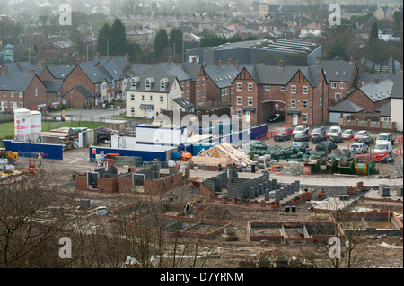 High view over new large urban housing estate under construction (some houses completed & some being built) - Guiseley, - Stock Photo