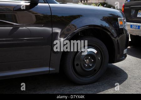 Spare wheel on car - Stock Photo