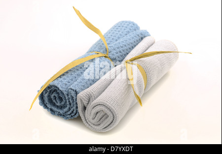 Wash cloths rolled up for spa treatment on white background - Stock Photo