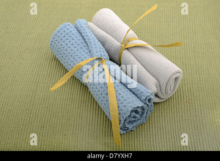 Wash cloths rolled up for natural beauty treatment - Stock Photo