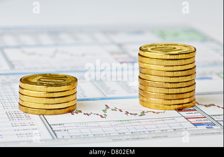 Financial chart and columns of golden coins. Successful trading.Selective focus - Stock Photo
