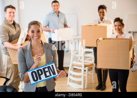 Business people opening new office - Stock Photo