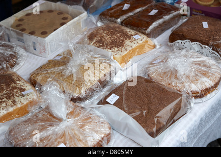 home made cakes on a charity stall at an outdoor event in the uk - Stock Photo