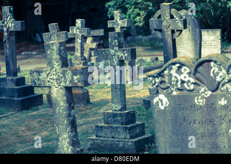 Old, weathered Grave stones in a English village church - Stock Photo