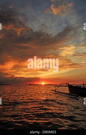 sunset on Bangka Island, North Sulawesi, Indonesia - Stock Photo