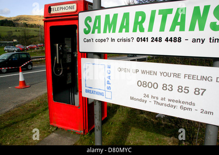 Samaritans and Breathing Space help lines signs beside phone box at pedestrian entrance to Erskine Bridge Glasgow - Stock Photo