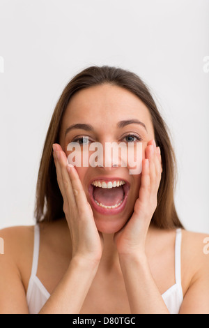 Portrait of a young lovely girl screaming out loud - Stock Photo