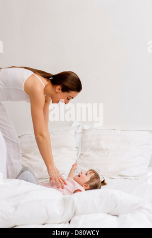 Portrait of a family at home in bedroom - Stock Photo