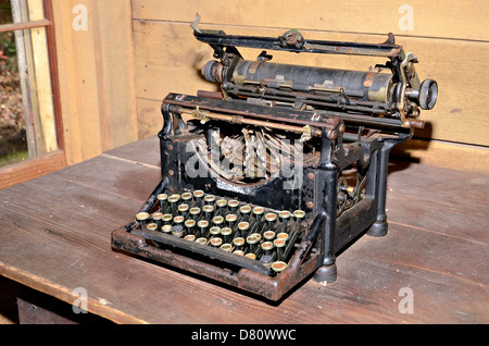 An old typewriter on display in a vintage setting. - Stock Photo