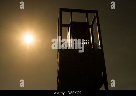 Silhouette of the Netherlands Carillon next to Arlington National Cemetery and the Iwo Jima Memorial. First donated in 1954, the Carillon was moved to its current location in 1960. It was a gift of the Netherlands to the United States in thanks for US aid during World War II. Stock Photo
