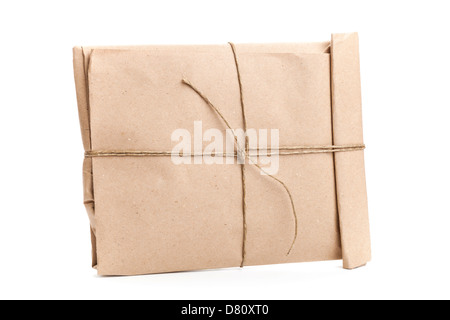 Closed envelope tied with a rope isolated on white background - Stock Photo