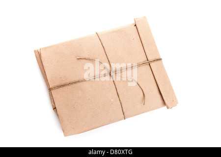 Closed envelope tied with a rope isolated on white with soft shadow - Stock Photo