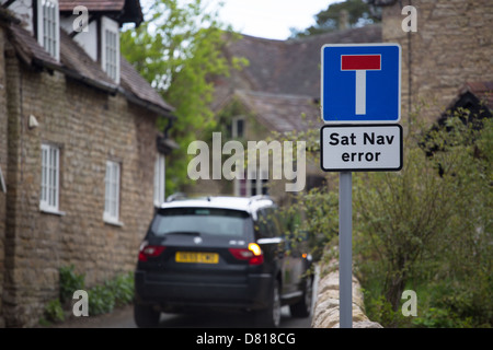 Sat Nav error sign in rural village indicates to motorists that their sat nav is likely to have made an error - Stock Photo