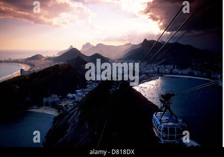 Sugar Loaf cable car and South zone of Rio de Janeiro Brazil Copacabana beach at left Enseada de Botafogo at right - Stock Photo