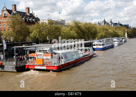 Cruise boats on the Embankment, River Thames, from Westminster Bridge, London, England - Stock Photo