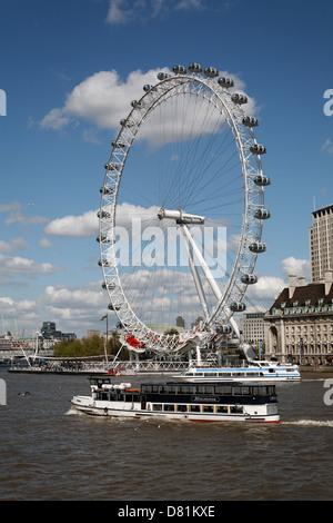 River Thames cruise boats, London Eye wheel from Westminster Bridge, London, England - Stock Photo