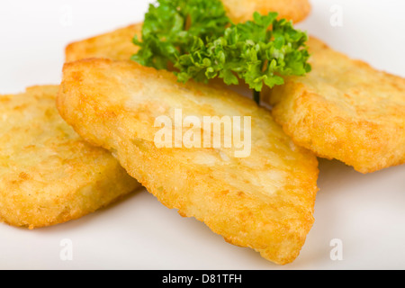 Hash Browns - Fried potato cakes. Breakfast side dish. - Stock Photo