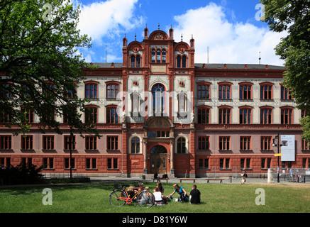 Student in front of University, Rostock, Mecklenburg-Western Pomerania, Germany - Stock Photo